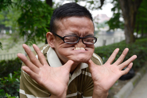 WSJ:  Tang Shuquan touched his nose with his teeth in Chengdu, Sichuan province, China, Tuesday. Mr. Tang won a Guinness World Record in March this year.  photo credit:  ChinaFotoPress / Zuma Press (via WSJ)