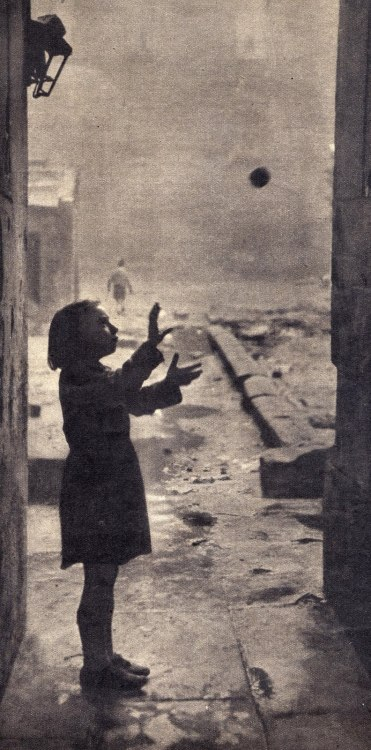 A young girl plays in the back-court of the Gorbals by Bert Hardy The Forgotten Gorbals, Glasgow, Scotland, 1948