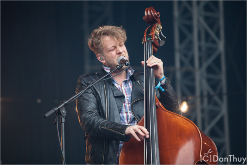 Ted Dwane of Mumford & Sons performs at Rock-a-Field in Roeser, Luxembourg on 24th June. Photo copyright Dan Thuy.