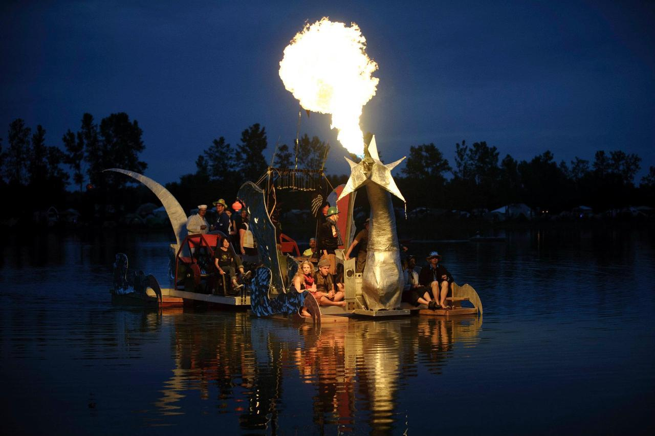 This is a fire-breathing dragon boat on a lake in Chicago. This is the Kickstarter project that made it possible. We like it!