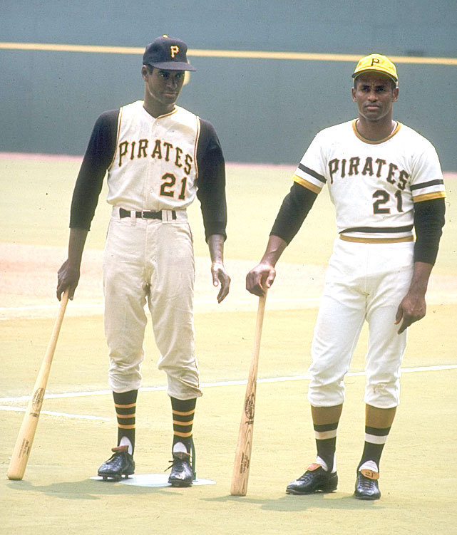Pirates outfielder Roberto Clemente stands next to statue of himself  before a 1970 game against the Astros. SI VAULT: The meaning of Roberto Clemente (4.10.06)