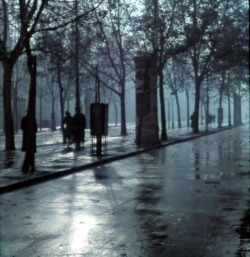 themetropolitanline:  firsttimeuser: The Andrássy Avenue in the rain, 1940 by Lajos Hollán