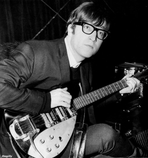 thegilly:  John Lennon at the Wolverhampton Gaumont, 19 November 1963. Scan from Beatles Book Monthly No. 274.   Oh, his glasses. If I was there, I would snatch at him! :-D
