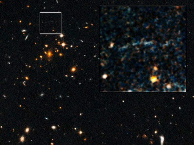 wired:  Astronomers have spotted one of the rarest and most extreme galaxy clusters in the universe and, behind it, an object that shouldn't exist.