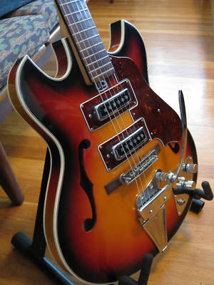 guitar-porn:  1960's Teisco. Not quite sure what model this is, it looks similar to an EP-2T but there are too many differences. Any of you educated types out there care to hazard a guess?  What!