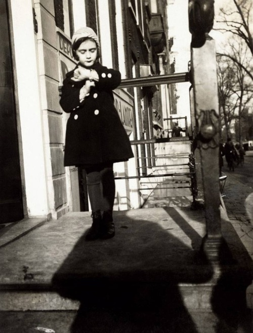 itsjohnsen:  A five-year-old Anne Frank stands on the steps of her father's office. Amsterdam, 1934. Otto Frank