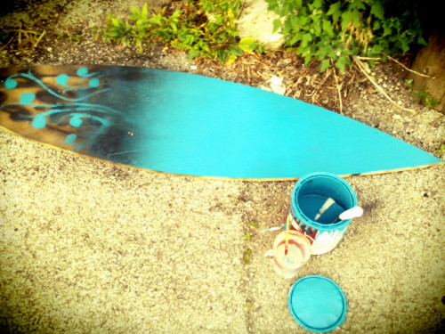 painting a wooden surfboard