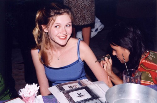 At an oh so hip Hugo Boss party in 1997, Kirsten Dunst pretends she really wants a tattoo of a random Chinese character on her arm.