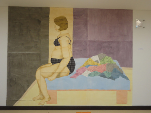 "fatpeopleart:  [Image: A painting of a fat, light skinned woman with short, sandy colored hair sitting on the edge of a bed in profile.  She's wearing dark lingerie with tiny while polka dots, and there is a pile of colorful clothing on the bed behind her.] ""Absent Bodies""by Angela PabónThe actual postmodern society through mass media, creates an endless cycle of deception and frustration in today's women. A war against the weighing balance and the mirror, that ties women to a fantasy ideal of a body and a poor body image.In this project I wish to speak about the bodies that have been excluded in the present cultural-historic moment. Absent bodies, because they're not represented and are excluded, in a society where all the present bodies have to correspond to the homogenous model promoted by the media. Bodies like mine, that are out of the beauty and health norms of society.Through watercolors and self-portrait as an expressive tool, I wish to expose mi body in different situations of passive frustration, when I encounter myself with the fashion industry; where my body is absent in its size and design rank.This is the last painting of my three real-scale self-portraits.""Closet""210cm (6.8 feet) high by 240cm (7.8 feet) wide. Watercolors and collage on Fabrianno watercolor paper. (Sumbitted by frenchtoastadventures)"
