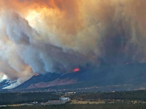 cbssports:  Scary image from the Colorado wildfires. That's the Air Force Academy's football stadium in the bottom-left corner.   Not my photo, but this is pretty close to the vantage point from my folks' house.  I've wandered all over those mountains, on and off trails.  Very sad.