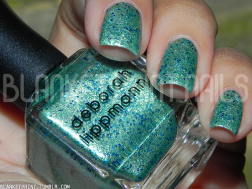 Color: Mermaid's Dream (Deborah Lippmann)Retail Price: $18.00 (USD) I've been wanting Mermaid's Dream for a while and finally got my hands on it, thanks to a nail polish swap with Vanessa, who follows Blanket Print Nails on Facebook. Now, in my experience, when you want something really bad for a long time, it sometimes doesn't live up to your expectations. I'm happy to report that isn't true in this case! Mermaid's Dream is a glittered shimmer with micro gold and seafoam green glitter and large blue hexagonal glitter throughout. I'd say this qualifies as a glittered shimmer because application is so smooth and effortless, unlike many other glitter polishes where the glitter is prone to move around on your nail during application. One coat of this nail polish is pretty dense, but still great to layer over a solid creme (like Deborah Lippmann's On The Beach, a bright sky blue creme)—perhaps to create a dazzling accent nail. For a fully opaque manicure, I needed two coats of Mermaid's Dream (as you can see in the photo above). This does dry a little bumpy/rough, so you'll want to use one or two layers of a thick top coat to finish up your manicure. Mermaid's Dream is so stunning it makes my heart ache!! Any nail polish aficionado seriously NEEDS this bottle of perfection. A+, Deborah Lippmann!