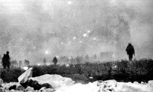 British infantry advancing through poison gas at Loos, France, 1915.