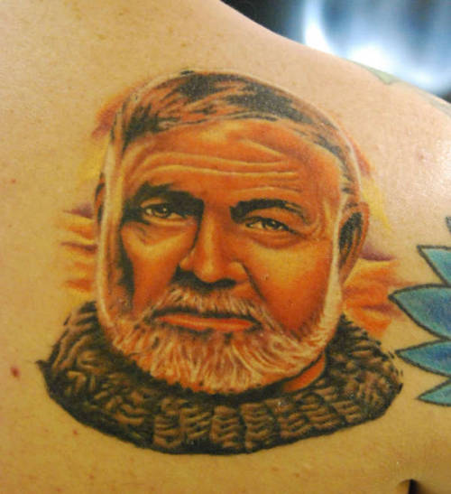 literary-tattoos:  If you are going to get anyone's face tattooed on you, it should probably be Hemingway. [x]  Via Moresongsaboutbuildings