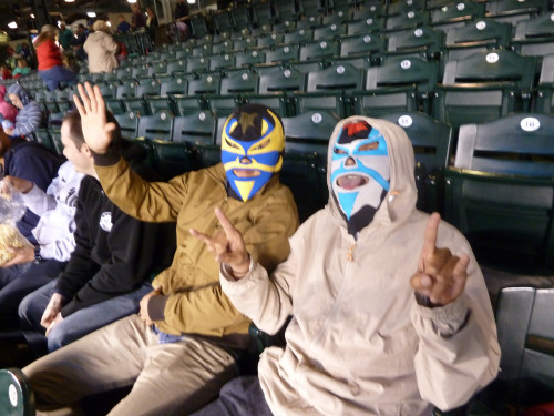 Masked fans take in Tuesday's game at Safeco Field.