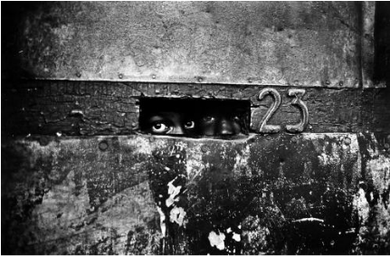 Bob Adelman     Peering Through the Mail Slot, Brooklyn, New York     1962