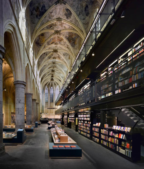arcilook:  Amazing Dutch Church Reconversion into Contemporary Library  This extraordinary church conversion proves that buildings can be re-purposed and still lend their original charm to the new establishment. The Selexyz Bookstore in Maastricht used to be an old church until Amsterdam-based architectural studio Merkx + Girod adorned the stunning interiors with contemporary library details that marry both styles. Gathered under the imposing ceiling of this 13th century Dominican church, thousands of books inspire people to follow their dreams while carefully constructing a view of the future – respecting past architecture while maintaining the interest for modern upgrades. The 1,200 square meter church features vertical multi-story bookshelves shaping a fascinating library interior design and a cafe showcasing a cross-shaped main table, with rounded tables and stools all around – this is the space formerly occupied by the choir. Keeping most of the original interiors intact, the architects managed to convert a holy space into a knowledge fountain.