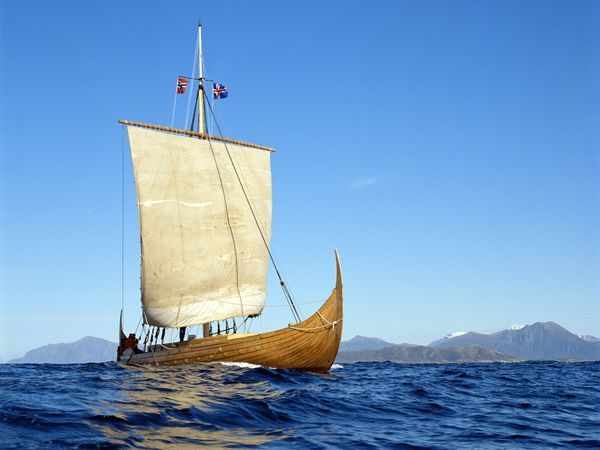 Replica Viking ship called the Gaia sailing under the flags of Norway and Iceland