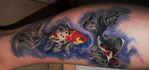 By Tony Cohen at The Illustrated Man Tattoo Studio of Fine Art, NSW, Sydney, Australia.  I decided to get this tattoo because I have always loved the story behind the Koi fish - if they succeeded in climbing the falls at a point called Dragon Gate on the Yellow River, they would be transformed into dragons. The day I got this tattoo I made a few life changing decisions, and I wanted something to remember my courage in changing my goals and aspirations. My largest and most favourite tattoo to date; I couldn't be happier with Tony Cohen's work on my calf.