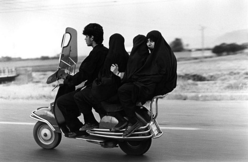 reprtg: © abbas, shahr rey, iran — young man and three veiled girls in a four-seater motorbike, 1997
