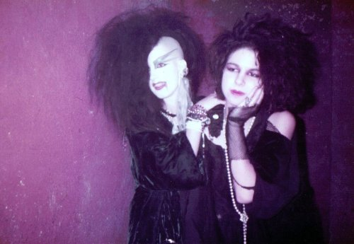 [Color photo of a couple of glorious old-skool goths]