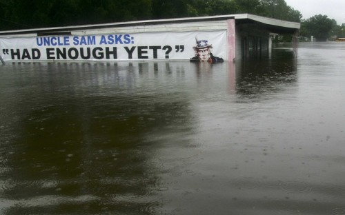 inothernews:  YES   A submerged sign is seen on a flooded business along Highway 129 in Live Oak, Florida. Tropical Storm Debby drifted slowly eastward over Florida's Gulf Coast on Tuesday, threatening to dump more rain on areas already beset by flooding.  (Photo: Phil Sears / Reuters via The Telegraph)  Says it all.