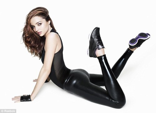 Miranda Kerr's booty in black latex. Yummy. Attention TUMBLR followers - please go vote in our Booty Battle!