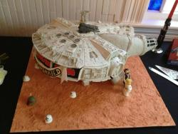 "dorkly:  Millenium Falcon Wedding Cake ""She may not look like much, but that's mostly because she's made of cake and frosting."""