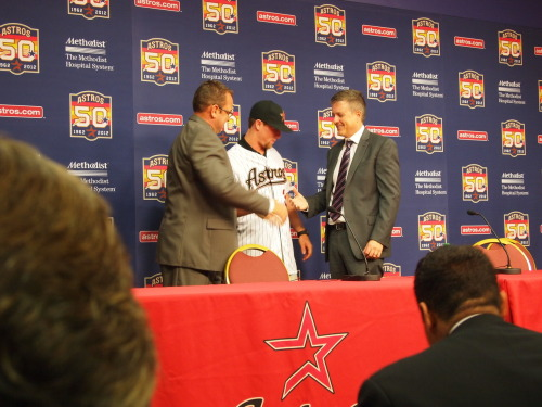 Nolan Fontana, the Astros 2nd Round 2012 Draft pick, receives his jersey from Assistant GM Bobby Heck and GM Jeff Luhnow.