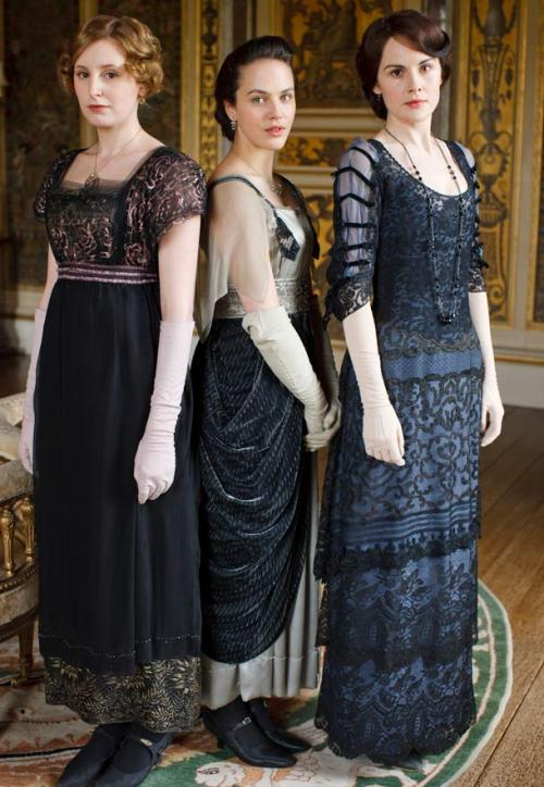 My favorite dress that Lady Sybil Crawley wears is this one with the black straps and white satin seen here in this picture.    I got this picture from http://downtonabbeyfashion.tumblr.com/