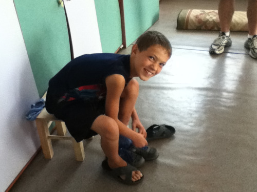 Oleg changing his shoes to leave the orphanage FOREVER!