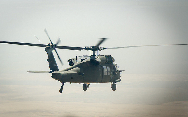 Flying High, by Omar Chatriwala. An American Black Hawk helicopter flying over Iraq