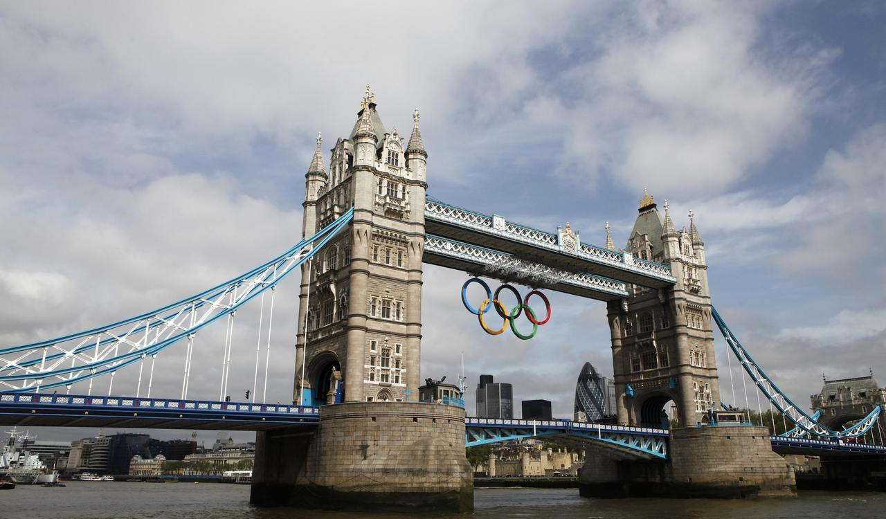 nationalpostsports:  TA DA! The Olympic Rings hang from Tower Bridge after being lowered into position for display from the walkways in central London, June 27, 2012.  The London 2012 Olympic games will begin on July 27.  REUTERS/Andrew Winning