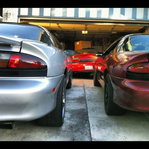 #z28 lifestyle. My Lil bros Dev Goon squad rep and 6speed moody. My little red thang in the lab in the background.  We do this!!! #chevy #chevy #camaro #muscle #musclecar #red #silver #ls1  (Taken with Instagram)