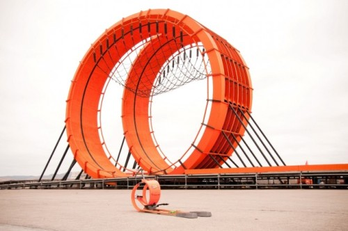Giant Hot Wheels Track With Double Vertical Loop and Real Race Car Drivers? Check.   The real double loop track next to it's toy version.