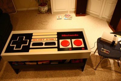 Functional Nintendo NES Controller Coffee Table Click here to see the full construction of this amazing table. Now someone needs to made a giant Duck Hunt Gun to match! S