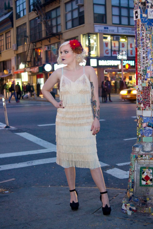 thecorcorangroup:  Twenties Style Flapper on 2nd and St. Marks Place…East Village, NYC (via Marion)  Stepping out to see Gatsby tonight? Unlike some of the socialites depicted, Jim's work has style and substance! Save your money and donate what you were going to spend on tickets to the Rebuilding of The Legendary Mosaic Trail on Indiegogo!