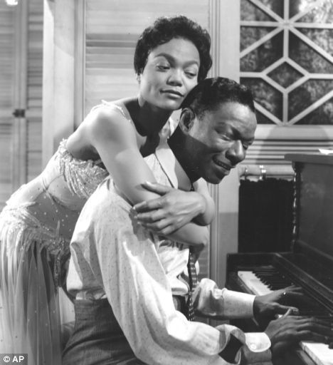 Eartha Kitt hugs Nat King Cole, 1960