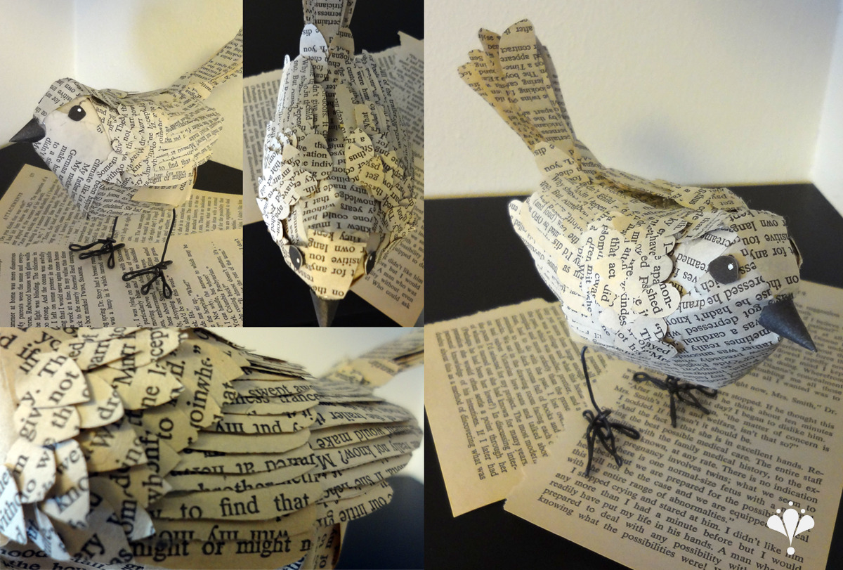 I made this bird for school out of an old book and hot glue, with wire feet and frame. Even her beak was made with part of the inside of the book's cover. She was a lot of work to make - each feather was attached individually!