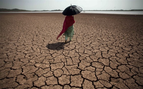 Dry, hot weather causes water shortages in Pakistan A Pakistani woman walks on a dry bank at the Rawal dam in Islamabad, Pakistan on Wednesday. The dam provides water to Islamabad and Rawalpindi cities, but the water level in the dams and rivers are low because of dry and hot weather causing water and energy shortage to civilians. Read the complete story.