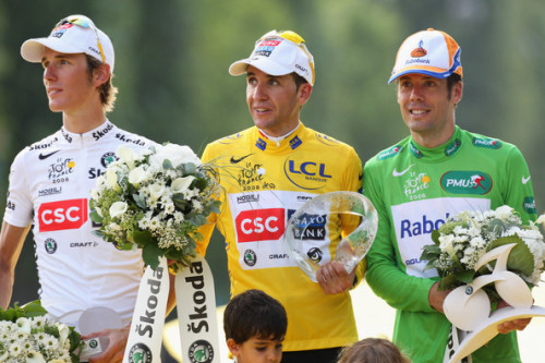 Green Jersey Points winner Oscar Freire of Spain and Rabobank (R),Yellow Jersey overall race winner Carlos Sastre of Spain and Team CSC Saxobank (C) and White Jersey for Best Young Rider winner Andy Schleck of Luxembourg and Team CSC Saxo Bank (L) celebrate on the podium during Stage Twenty One of the Tour de France on July 27, 2008 in Paris, France. (July 27, 2008 - Source: Bryn Lennon/Getty Images Europe) (via Oscar Freire Pictures - 2008 Tour de France - Stage Twenty One - Zimbio)