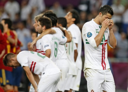 nationalpostsports:  Someone is having a sad. And that someone is Cristiano Ronaldo. It makes sense - Portugal lost to Spain on penalties on Wednesday afternoon and was eliminated from Euro 2012. If you're a Spain fan, it means your team is now in the final and must wait for the winner of Italy vs. Germany to find out the next team.  Sad Cristiano… I bet the Ukrainian men are celebrating hard tonight!