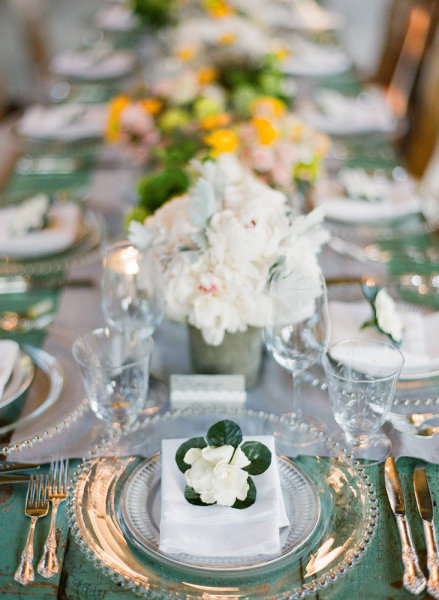 This gorgeous teal isn't a linen - it's the color of the distressed table top! If you need to rent tables, why not go for one that doesn't require a linen rental on top of it?