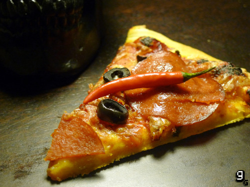 "gourmetgaming:  Request: Devil May Cry 3 - ""Dante's Inferno"" Pizza  Recently, our copy of the Devil May Cry HD collection finally found it's way to us so we've been reliving the gaming past. I'm a huge fan of the first Devil May Cry; I played it many times, but never bothered to pick up any of the sequels. It wasn't until a couple of people started telling me how amazing the third instalment was that I thought I should probably give it a go, and you probably would too if someone told you they quit a job to play the game full-time when it came out. I've made pizza twice before for Gourmet Gaming, so this time I thought I'd kick it up a notch with this ""Dante's Inferno"" recipe. A chilli base, with chilli sauce and chilli cheese, topped with spicy pepperoni and Dante's detested black olives – one bite is sure to drag you to hell. At least your tears will prove your humanity. This recipe makes 4 pizzas. What you will need: A large mixing bowl, a sieve, a rolling pin and a pizza tray or pizza stone. For the Chilli Dough: 500g / 3⅓ Cups '00' or Strong White Flour ½ Teaspoon Salt 325ml / 1⅓ Cups Warm Water 1 Sachet (7g) Dried Fast Action Yeast ½ Tablespoon Sugar 2 Tablespoons Chilli Infused Olive Oil 1 Teaspoon Chilli powder For the Topping: 150g / 1 Cup Tomato Purée ¼ Teaspoon Dried Chilli Flakes Salt & Pepper ½ Teaspoon Dried Oregano 1 Red Birdseye Chilli (Finely Chopped) 250g / 1½ Cup Hard Mozarella (Grated) 75g / ½ Cup Spicy Hard Cheese (Grated) 20 Medium Pepperoni Slices 50g / ½ Cup Pitted Black Olives (Sliced) Making the Pizza Dough: Sieve the flour and salt into a large mixing bowl. Meanwhile, in a jug, pour in the warm water and add the yeast, sugar and olive oil to it. Mix well, and allow the the mixture to stand for a few minutes. Make a well in the flour, and pour the water and yeast into the middle. Sprinkle in the chilli powder. Using a fork, mix the flour into the water until the dough begins to come together. Once a ball has formed, turn the dough out onto a floured surface, and with floured hands kneed the dough well for about 10 minutes. It should be warm, and make a smooth ball when ready. Return the dough to the large bowl, cover and sit in a warm place to rise for about an hour. Making the ""Dante's Inferno"" Pizza: Preheat the oven to as high it goes, usually about 250C/480F. Place your pizza tray/stone in the oven to warm up. Meanwhile, roll out a portion of the dough into a rough circle to fit your tray – the ideal base should be very thin. Carefully remove the warm tray from the oven, and line the tray with the rolled out dough. Trim any excess edges so that you have an even circle. Next, cover the top of the pizza with some tomato purée, and use the back of a spoon to spread it around. Season to taste with salt and pepper, then sprinkle on the dried chilli flakes, oregano and fresh, finely chopped red chillies. Next cover with a layer of cheese, combining the mozzarella and chilli cheese. Finally, place the pepperoni and black olives before putting in the oven until golden brown and crisp.  Most people will get injuries from sports growing up, I got them from playing Devil May Cry in the form of chronic wrist and arm cramps; ""Dante Must Die"" seems to be more a case of ""Dani Must Die"" - and this is pretty much how this fiery dish will make you feel. Hot to its very core, but still flavoursome and subtle (a little like Dante himself), ""Dante's Inferno"" is truly the nine circles of hell. And remember; devils never cry. Like this? You might also enjoy punching yourself in the face."