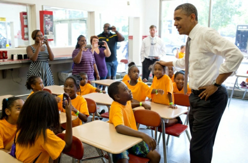President Barack Obama talks to a group of kids from Lenora Academy in Snellville, Ga., during a stop at the Varsity, a restaurant in Atlanta, Ga., June 26, 2012. (Official White House Photo by Pete Souza)