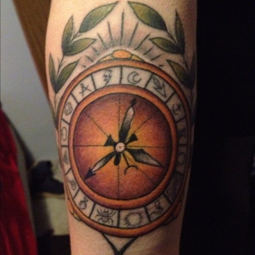 "Alethiometer tattoo inspired from the trilogy ""His Dark Materials"" written by Phillip Pullman. I had this done on my birthday (27/06/12) by the artist Sam Kane at Ocean Ink in Sydney, Australia. Artists link: http://www.facebook.com/sam.kane3  me: www.mil0ff.tumblr.com"