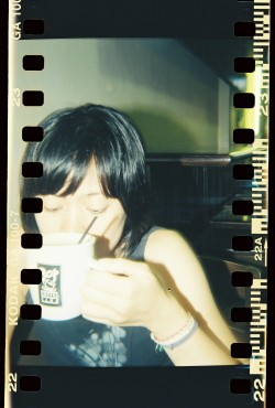 She sips more of her coffee for a much better morning. Holga 120N by Melancholik