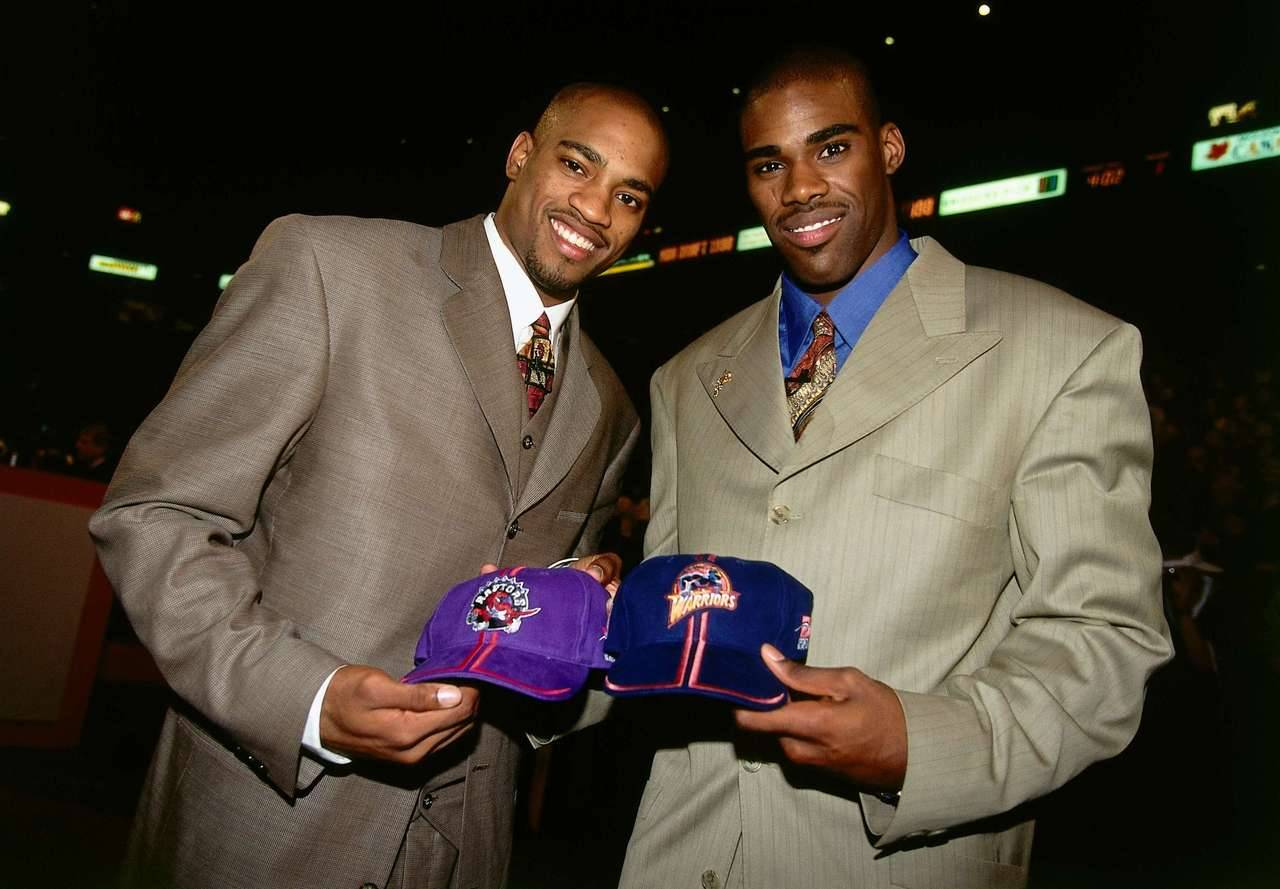 nba:  June 24, 1998: Antawn Jamison & Vince Carter are traded for one another at the 1998 NBA Draft. (Photo by Andrew D. Bernstein/NBAE via Getty Images)  I still remember this. I thought it was an awful idea at the time. Now I'm so glad they did it!