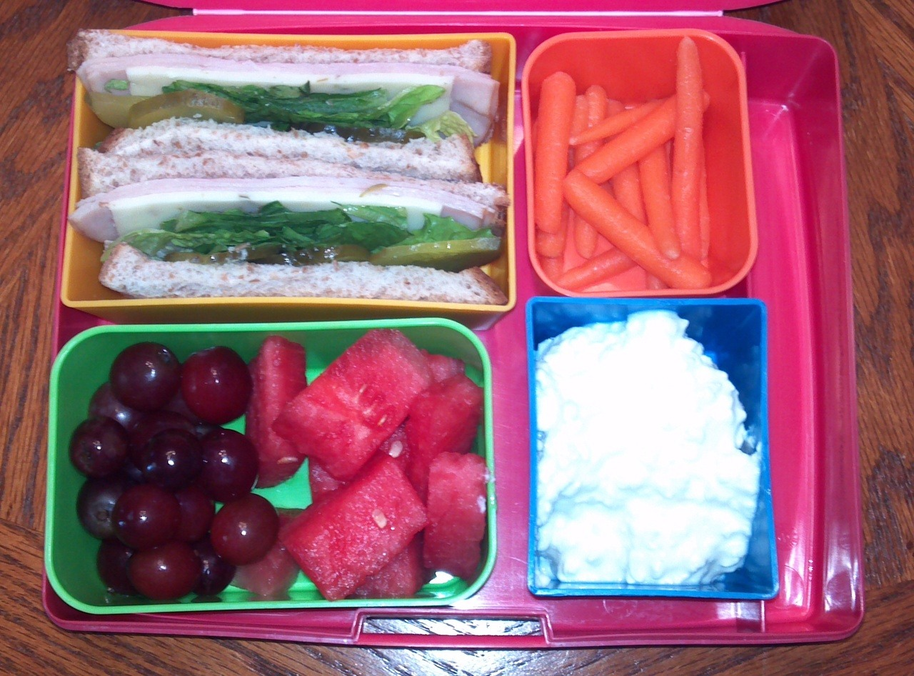 Turkey sandwich, low fat cottage cheese, baby carrots, grapes, and watermelon. Loving how colorful my meals have become :)