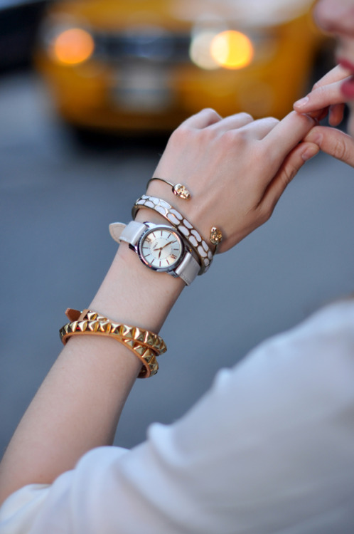 The skull cuff is the perfect start to this sophisticated arm party… Loving the gold and white together!  Check out what's missing -   White Chocolate Gold, White and Rhinestone Statement Hinge Bracelet