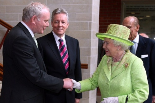 Queen Elizabeth II and a former Irish Republican Army commander offered each other the hand of peace Wednesday in a long-awaited encounter symbolizing Northern Ireland's progress in achieving reconciliation after decades of violence.  The monarch and Martin McGuinness met privately inside Belfast's riverside Lyric Theatre during a cross-community arts event featuring many of Northern Ireland's top musicians, poets and artists. Media were barred from seeing their first handshake, but the two shook hands again a half-hour later for a TV camera and two photographers.  (click-through for full story)